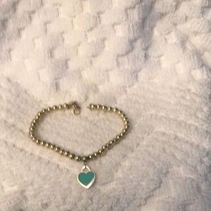 TIffany 925 beaded bracelet w/ blue heart charm.